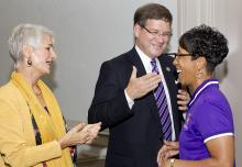 UNI President Bill Ruud and his wife, Judy chat with UNI Head Women's Basketball Coach Tanya Warren